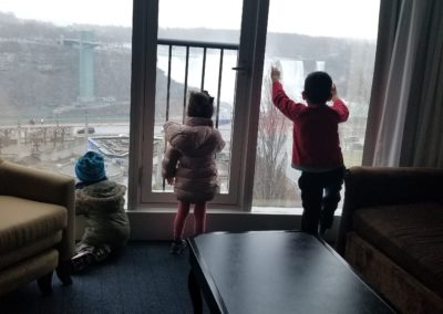 children overlooking falls from window